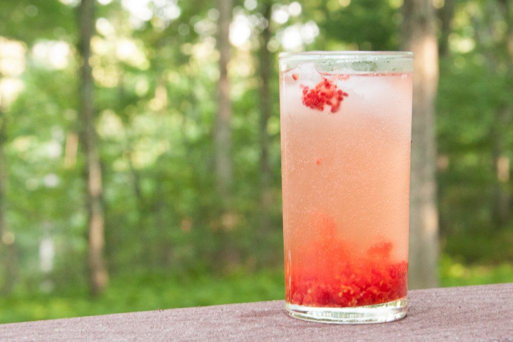 an elderflower - wineberry wildcrafted cocktail